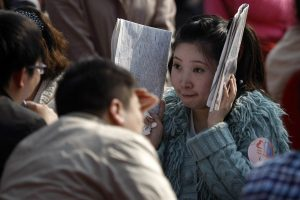 A single Chinese woman engaged in speed-dating at the First Annual Matchmaking Fair in Shanghai.