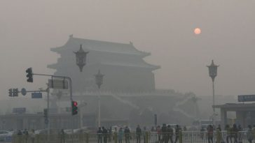 Beijing's Qianmen Jianlou shrouded in polluted fog.