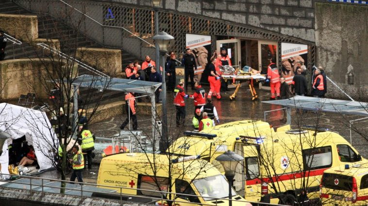 Ambulances and rescue workers evacuating the wounded after an attack in Liege, Belgium.