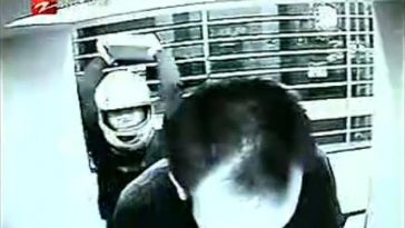 In China, a man wearing a helmet uses a brick to strike bank ATM users in the head to knock them unconscious and rob them of their money.