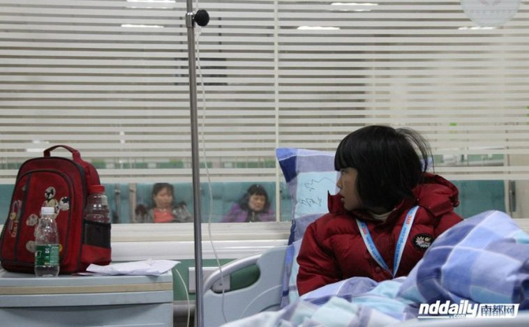 A young child at Lecong Hospital in Foshan, China under observation following her school bus colliding with a truck.
