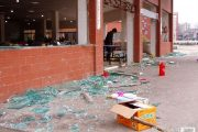 Shattered glass scattered on the ground outside a middle school cafeteria in Guizhou, China suspected by students of using drainage oil.