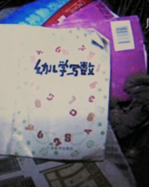 Various notebooks and belongings of the children killed and injured in a Jiangsu school bus rollover accident.