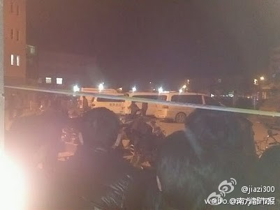 Parents outside a hospital in Jiangsu after a school bus rolled over in a traffic accident.