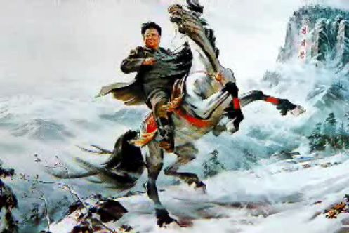 Kim Jong-il riding a horse on a snowy mountain.