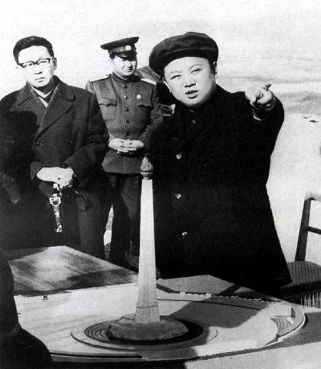 Kim Jong-il overseeing the construction of a memorial.