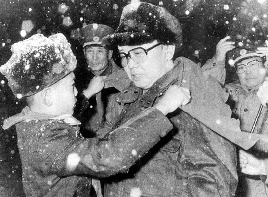 Kim Jong-il and a young boy in the snow.