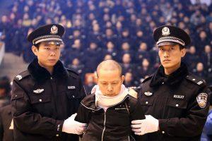 Changsha tax bureau bomber Liu Zhuiheng in the Hunan University North Campus Gym receiving his death sentence.