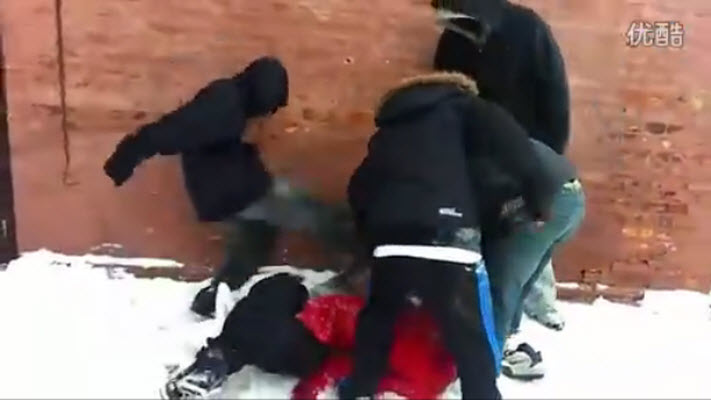 A group of teenagers kicking and beating a Chinese boy in Chicago.