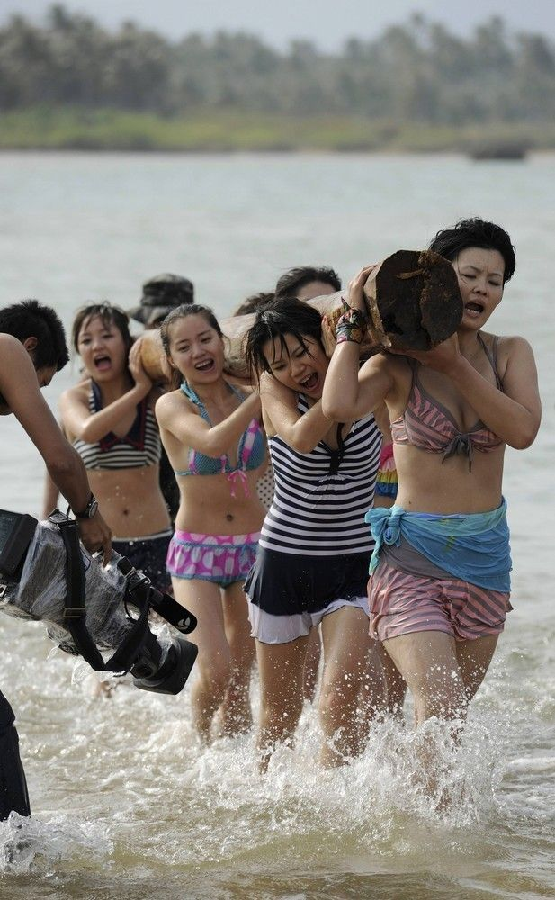 Chinese Female Bodyguards Training on Beach in Swimsuits ...
