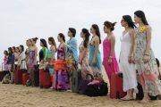 A row of young Chinese women gathered on a beach in Sanya, Hainan of China to train as female bodyguards.