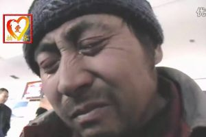 A Chinese migrant worker with tears in his eyes.