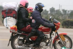 A Chinese family of three riding a motorcycle braving the winter weather to go back to their hometown for the Chinese New Year holiday.