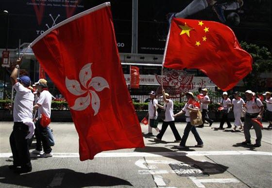 Hong Kong 1997 handover anniversary parade with Hong Kong and Chinese flags.