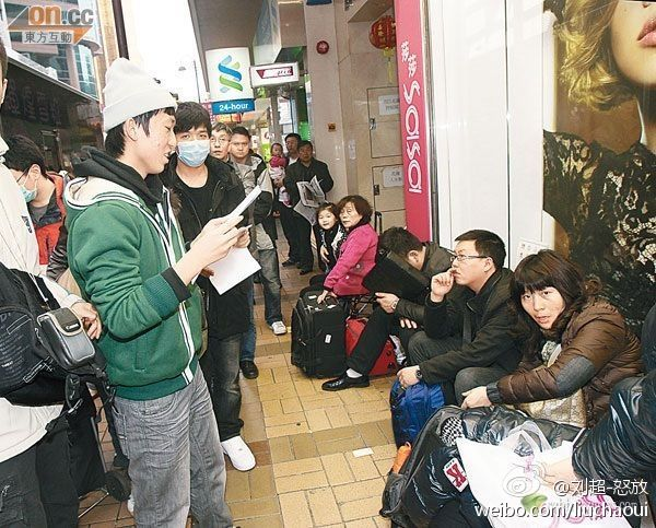 "Hong Kongers harassing mainland tourists on the streets of Hong Kong, singing ""Locust World""."