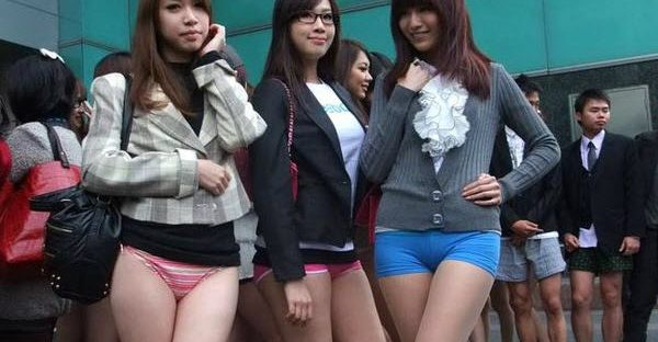 Young girls in Taiwan go pantless for a day, emulating New York's No Pants Day.
