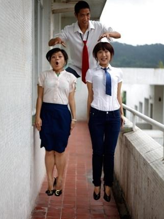 Shantou University graduates simulate levitation.