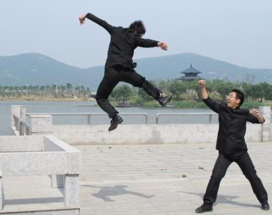 Chinese graduates perform flying kung fu.