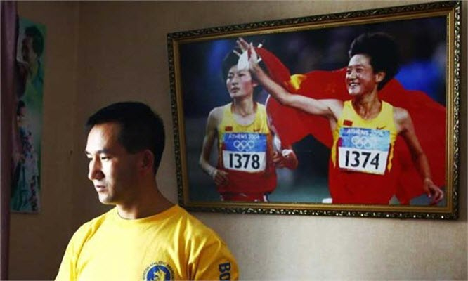 Chinese coach Wang Chengrong is being pressured by his superiors to hand over over 1 million in award money he received from the China Disabled Persons' Foundation.