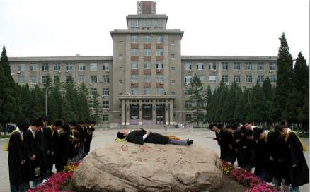 Chinese university graduates simulate funeral.