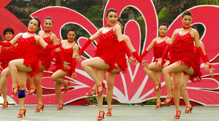 Female staff at the State Administratin of Taxation bureau in Nanning city of Guangxi province of China hold a dance competition.