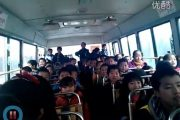 A video of bus full of schoolchildren in China singing a popular internet meme song has gone viral.