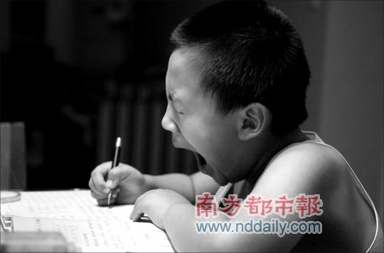 Chinese little boy yawning.