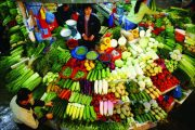 A wide assortment of vegetables on display at a Chinese vegetable vendor's stall in a China wet market.