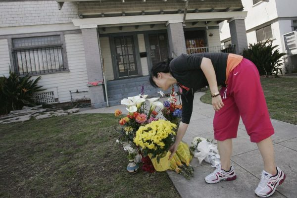 USC student leaving flowers at the site where two study abroad Chinese students were shot dead.
