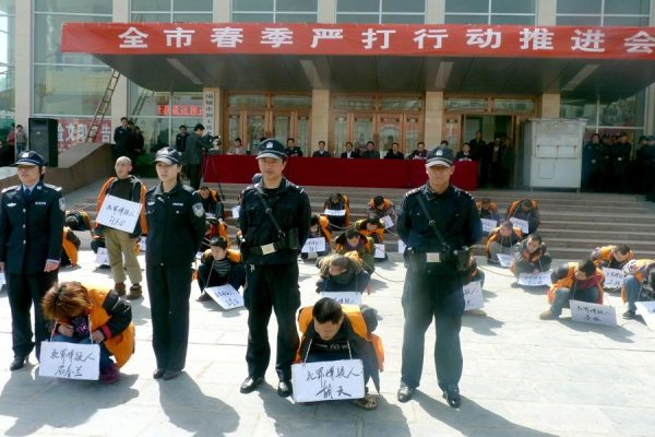 "A city in Henan publicly shamed and sentenced 51 criminal suspects in a spring ""crackdown,"" while netizens question the legality and morality of the proceedings"