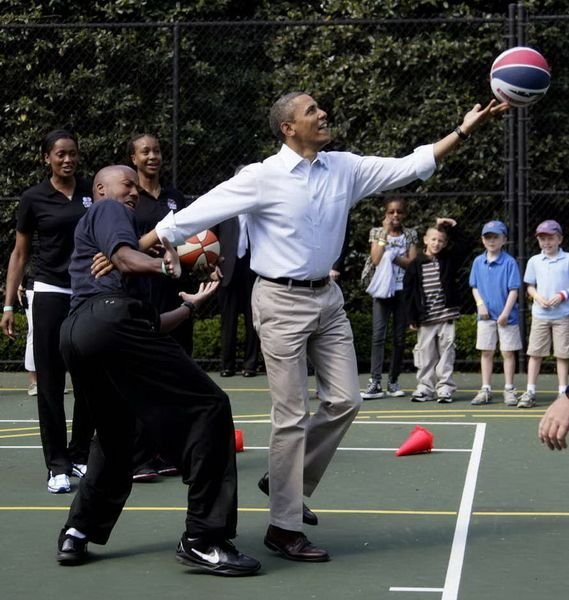 Obama is playing basketball with Bowen.