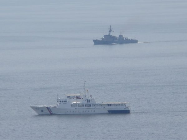 A Philippine coast guard vessal in a stand off with a Chinese surveillance ship near Scarborough Shoal in the South China Sea..