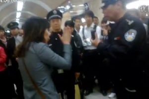 A Beijing woman shouts 'I'm a lawyer' after reportedly slapping police who blocked her bringing her bike onto the subway, drawing intense criticism from netizens.