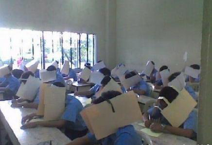 Chinese students with folders hung around their heads to prevent cheating during tests and exams.