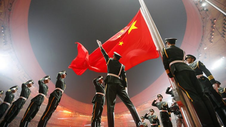Chinese soldiers raise PRC flag during the 2008 Beijing Olympic ceremony.
