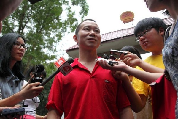 Deng Mingjian is getting a interview.
