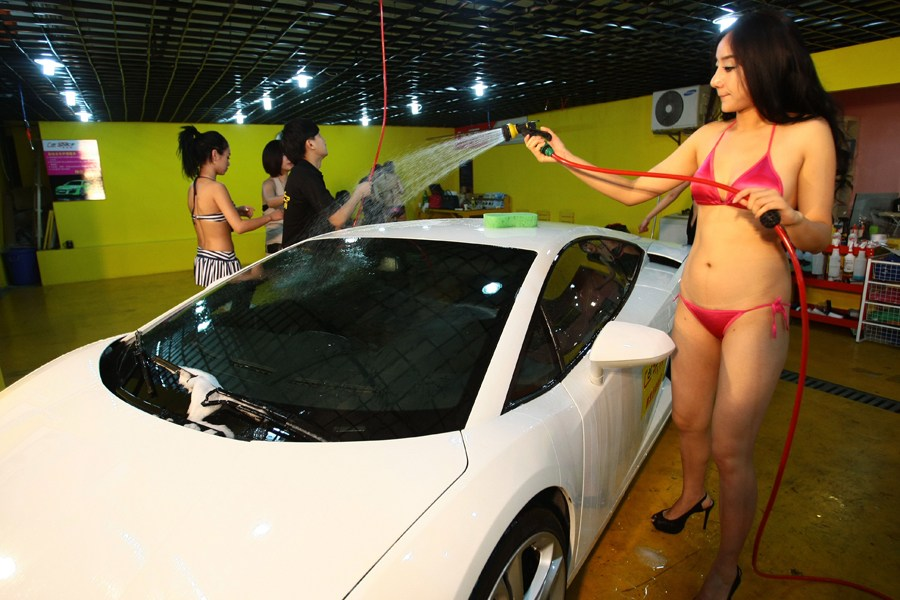 Bikini girls washing tractor very