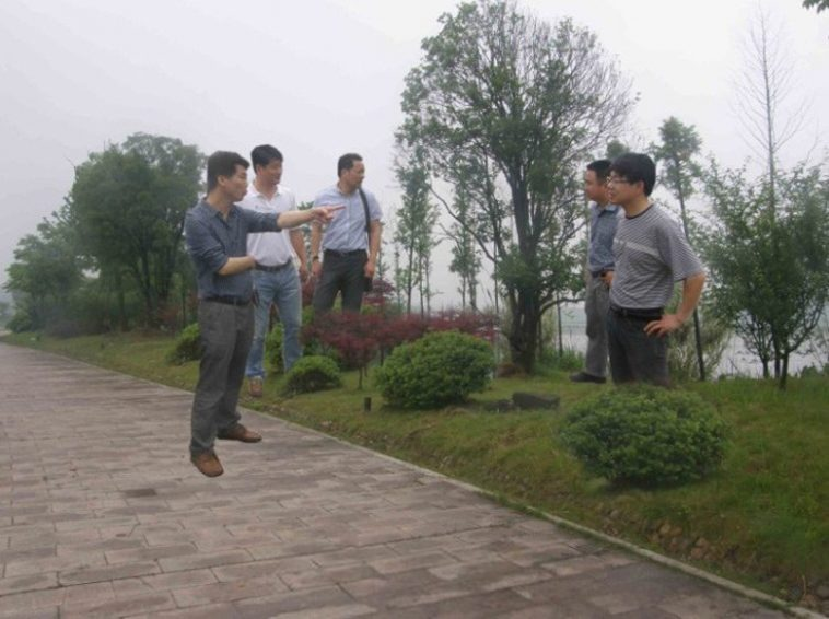 "Hangzhou Yuhang District Chinese government officials in a obviously photoshopped image where they appear to be ""floating""."