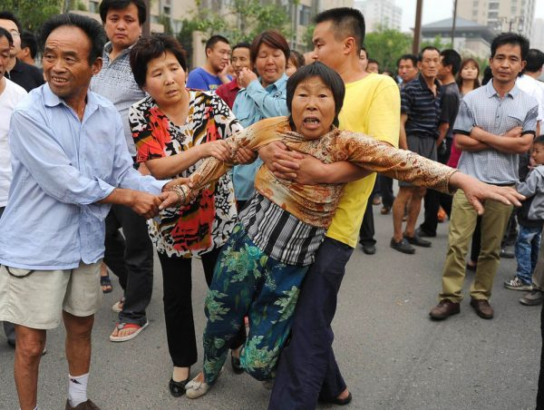 Grieving famil members at the scene of the accident in Xi'an, China.