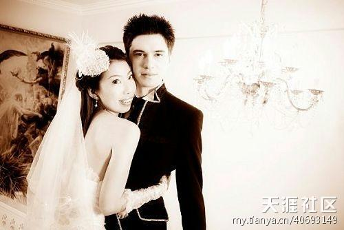 a wedding photo of a plain-looking Chinese woman and her Western husband