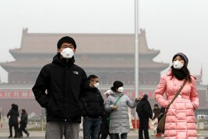 Chinese residents in Beijing wearing face masks due to the visible air pollution and poor air quality..