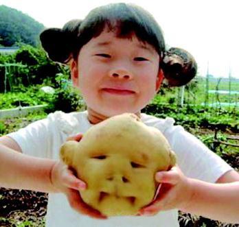 girl and potato
