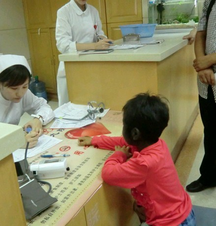 Lili and a nurse filling out paperwork.