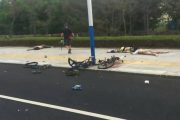 A scene of the wreckage and bodies of the bikers