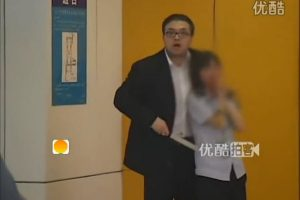 A Chinese man holding a female security checkpoint worker hostage in the Beijing Subway at Hujialou station.