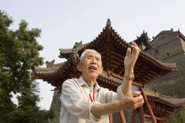 An old Chinese man practicing taiji in Xi'an.
