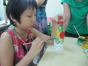 Golden Wings charity Chinese children making art.