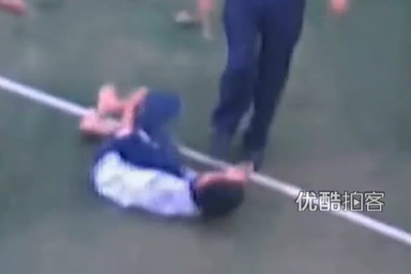 A Chinese teacher kicks a middle school student at a school in Hainan, China.