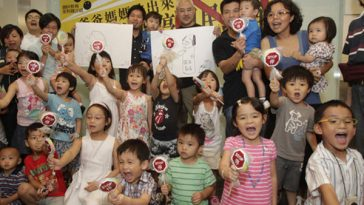 Hong Kong parents and children protesting against the mainland's national education program.