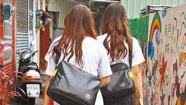 Several high school girls in Taiwan in school uniforms.